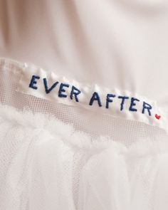 """Homespun touch: Kate used her skills with a needle and thread to stitch the phrase used on the save-the-dates and a heart into the lining of her dress to make her """"something blue."""""""