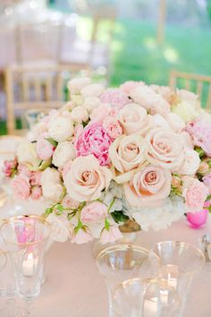 A lovely pastel centerpiece of classic roses mixed with peonies & garden roses.