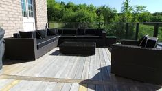 Brown wicker with black sunbrella cushions with white pinstripes