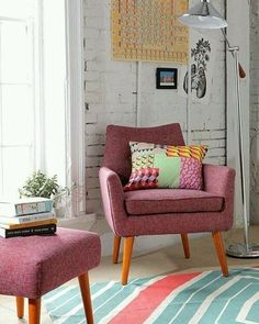 Good positioning of the chairs, and the color scheme adds a hopefully, but calm color scheme. Also, the natural light adds warmth to the room.