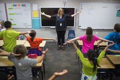 """Peace teacher Linda Ryden leads students in exercises during a fourth-grade """"peace"""" class where kids learn mindfulness techniques at Lafay..."""