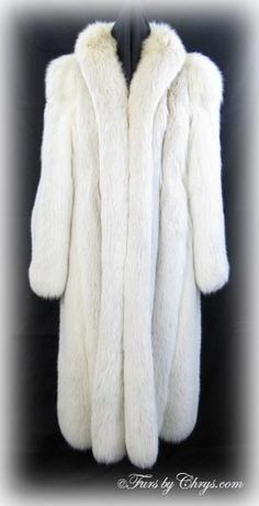 Blush Fox Coat BF768; $2000.00; Very Good Condition; Size range: 6 - 10. This is a stunningly gorgeous genuine blush fox fur coat. Blush fox is not quite white, as it has beige undertones. It has a Gartenhaus label and features a tuxedo collar and straight sleeves. This is a very high quality fox fur coat with nice, wide pelts and the fur is super full and fluffy.