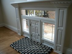 Custom made doggy door with real glass and removable grids. Just open the six panel door and the puppy can get outside.