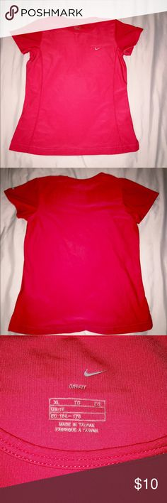 Nike Dri-Fit athletic shirt Worn a few times for working out! It's a size XL but it runs very small. I'm usually a medium to large and this fit me perfectly. It's in great condition! Nike Tops Tees - Short Sleeve