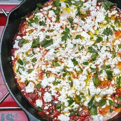 Breakfast Shakshouka To scoop up every bit of this spicy egg and tomato dish, popular in North Africa and Israel, we brushed slices of pain au levain with oil, then toasted them on a grill pan set on a camp stove.