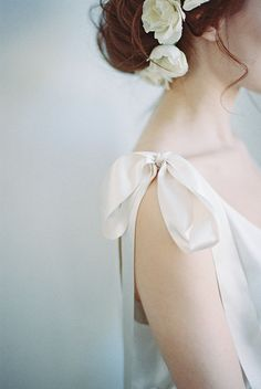 bow detail and floral hair