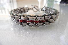 Stainless Steel Hex Nut Bracelet with Red Swarovski Roundels by BeautifulLanyards on Etsy https://www.etsy.com/listing/151296113/stainless-steel-hex-nut-bracelet-with