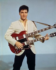 Elvis Presley playing a Gibson Double Neck