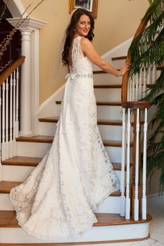Congratulations Alison! Alison is wearing a gorgeous lace halter wedding dress with a beaded sash! Love her look?Come to Mary's Designer Bridal Boutique to find your perfect look for your wedding!