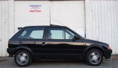 My first new car - a Citroen AX GT -it had a spoiler  and alloys right from the factory - woo and indeed too!  It weighed about 700kg dripping wet and revved at 4000rpm at 70mph.  Relaxing on the long schlep up the M6