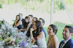 The wedding party at the head table. Michigan outdoor wedding