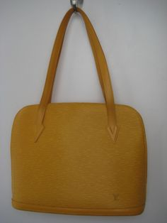 Louis Vuitton epi leather 'Lussac' bag. Double strap bag with top zip closure. Suede lining with 1 zip & 1 slip pocket.