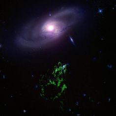 """Galaxy IC 2497 and the Green Blob, a renowned cosmic structure also called """"Hanny's Voorwerp"""" (Dutch for """"Hanny's object"""")."""