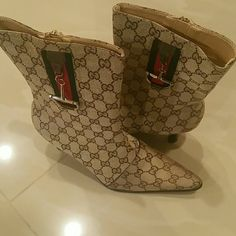 [NO LONGER AVAILABLE: DO NOT BUY]Boots Gently used designer Gucci boots with kitten heel....add this pair to compliment any outfit. Gucci Shoes