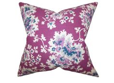 A bold floral pattern in shades of white, purple and blue adorns this eye-catching accent pillow. This throw pillow makes a great statement piece in your living room, bedroom or lounge area. Click to Buy #flowerpillow #pillow #floralpillow