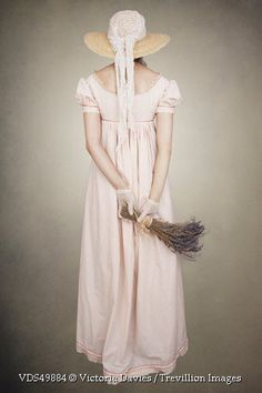 Trevillion Images - historical-woman-with-hat-and-lavender
