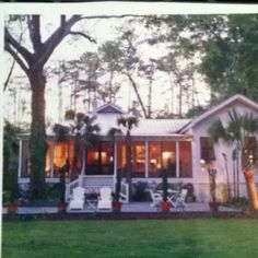 Beach house, love the soft light coming from the inside, casual front porch