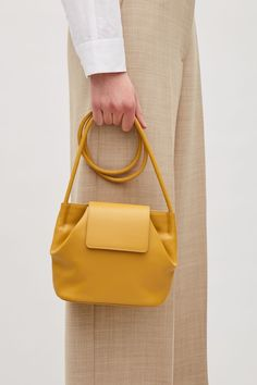 COS image 2 of Small shoulder bag with soft fold in Yellow