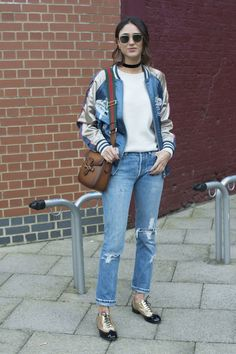 Click for more fresh spring style and outfit ideas. We love a silky bomber jacket with ripped straight-leg jeans and flat oxfords.