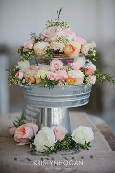 I love this for centerpieces! use a tin can base, glue on a pretty pie plate, glue in a small cake stand (or a candle holder and a tea cup saucer) and then fill in with cupcakes and flowers! beautiful centerpieces and dessert at every table!!!! by letha