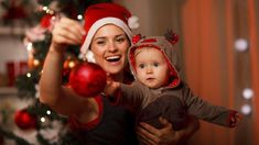 You are never too young to learn the art of Christmas tree decoration. What a lovely photo canvas!