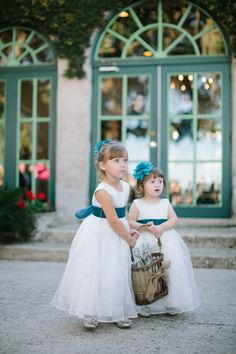 flower girls in white and blue  http://www.weddingchicks.com/2013/09/19/carefree-garden-wedding/