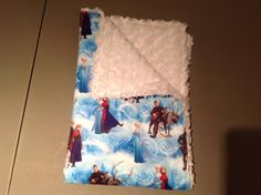 small stroller or car blanket. frozen with white on the back. super soft hand made blanket makes a wonderful gift.