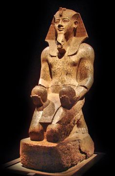 Statue of the pharaoh Amenhotep II (1427-1401 BC) offering two vases of wine to a God, from the Temple of Amun at Karnak. Now in the Egyptian Museum, Turin. Photo Jean-Pierre Dalbéra on Flickr.
