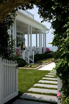 I want to live here! The house, the ocean, the porch...oh my!