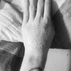 White ink tattoo is in trend! It is so romantic that will go well with your wedding dress. Or try white lace tattoo stickers, maybe?