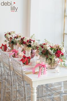 """Whether you're celebrating Valentine's Day or """"Galentine's Day,"""" this debi lilly design™ set up is sure to impress! Mix and match bright pinks, reds and whites for a full and festive tablescape all of your guests will love. Pro Tip: Add a take home gift to each place setting!"""