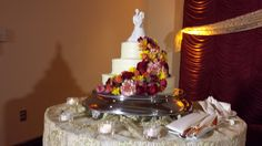 Amazing Three Tier Wedding Cake with Cascading Flowers.