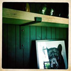 Black Steel Shelf Brackets On Black Wall With Bear Painting