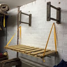 Hockey station made for my son out of upcycled materials. Bag goes on the shelf. Shorts, jerseys and body armour hang on a rail underneath the shelf. Sticks fit into the ladder rungs overhead. #hockey #upcycling