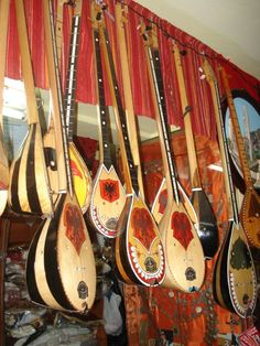 "Our national instrument is the ""Cifteli"". It is a plucked string instrument with 2 strings. We use it in traditional events, to accompany epics & ballads."