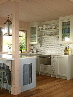 Cottage kitchen. Love the wood on the Island