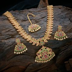 Its completely traditional set jewell, witch used red,green stone and white pearl www.shopzters.com