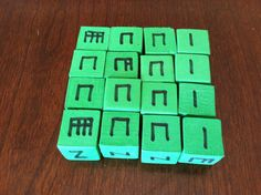 I just did this! Buy a set of foam blocks at the teacher store and write the rhythms for each unit.  Give each student/group a set of 4 and have them roll and read.