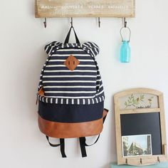 "Color: Brown/Dark Blue/ White & Black  Material: Sweater fabric  Size: Heigth:42 CM(16.54"" )  Width:28 CM(11.02"" )  Bottom Width:14 CM(5.51"" )   Interior Construction: Two patch pockets.  Exterior Construction:Handle top. Two bear ear decoration. Adjustable strap. Zipper placket along th..."