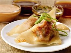 Chinese Beef Pot Stickers with Quartet of Dipping Sauces -- Ground Beef, mushrooms, garlic and green onions inside a wonton wrapper—served with your choice of sauce.