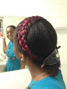 Protective hair style for relaxed afro hair wearing a colourful crown in a ponytail
