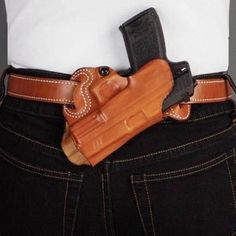 """B holster secures your pistol in one of the least obtrusive and most discrete areas for concealed carry. This holster is carried in """"butt up"""" position. Available in black or tan unlined leather. Sob Holster, Pistol Holster, Leather Holster, Small Of Back Holster, Edc, Taurus, Concealed Carry Holsters, Ccw Holsters, Leather Projects"""