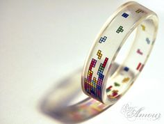 Tetris bangle: ParAmourDesign-- Looking for images for something I was working on, came across the perfect tetris bangle. They individually laid out each of the blocks in clear resin. That takes serious love. Jewelry Box, Jewelry Accessories, Jewellery, Nerd Jewelry, Jewelry Rings, Bangle Bracelets, Bangles, Gadgets, Clear Resin