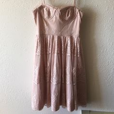 Rose Lace Dress Like new lace dress in a rose color. No obvious wear. Would be great at a spring or summer wedding or another special event! The top is ribbed and has a little padding in the bra area. Forever 21 Dresses Midi