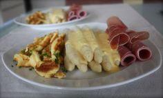 German dish called kaiserschmarrn with asparagus and prosciutto - original german recipe