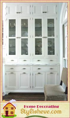 Built-In Hutch with Glass Doors. I love the floor to ceiling. Like the glass shelves with this.
