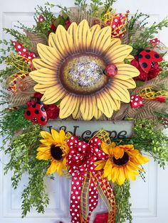 Sunflower and Ladybug Spring / Summer Mesh Wreath by WilliamsFloral on Etsy https://www.etsy.com/listing/273476748/sunflower-and-ladybug-spring-summer-mesh