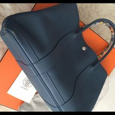 Authentic Hermes Garden Party 36 blue Bought this in 2014, still have the original box, dust bag and shopping bag. Great condition, only have some scratches on the corner of the bottom. My pictures are only without anything in it. I have photos with me carrying it if you are interested. Hermes Bags Totes