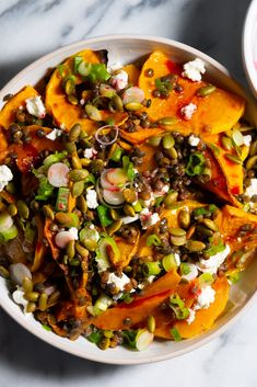 NYT Cooking: The secret to making winter squash taste even better is to bump up its sweetness by roasting it, then pair it with sweet and sour ingredients, like this pomegranate molasses and honey dressing. Thinly slicing the squash speeds up roasting time, and, if you have access to precooked lentils, feel free to add them here. You can also substitute other soft, creamy cheeses for the feta, such as goat ... Vegetarian Main Dishes, Vegetarian Entrees, Roasted Butternut Squash, Light Recipes, Lentils, Feta, Food Dishes, Cooking Recipes, Healthy Cooking