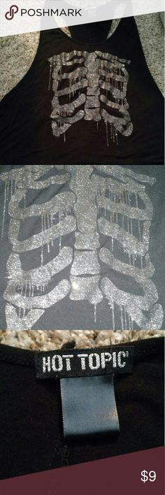 Hot Top Ribcage Tank Top Long and loose Hot Topic tank top with a glittery ribcage design. Large openings for the straps that end approximately near the hip. A bit low-cut with a racer back style. Medium, but can probably fit a large. No tears or stains. Closet closing 8/25/16 due to college Hot Topic Tops Tank Tops